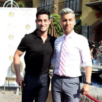 Lance Bass' hired surrogate could be pregnant within the next month