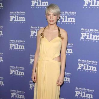 Michelle Williams dances with Hugh Jackman on set