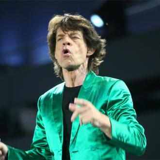 Sir Mick Jagger Comforted By His Children In La
