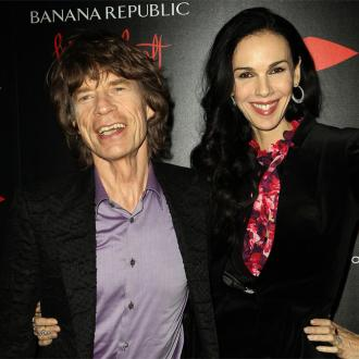 Sir Mick Jagger honours L'Wren Scott with costume