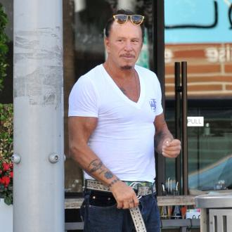 Mickey Rourke has beaten Elliot Seymour in a boxing match