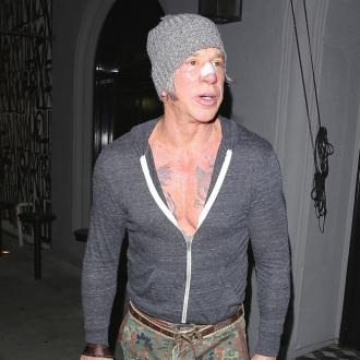 Mickey Rourke 'hooked on surgery'