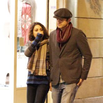 Mila Kunis Takes Ashton Kutcher To Wedding