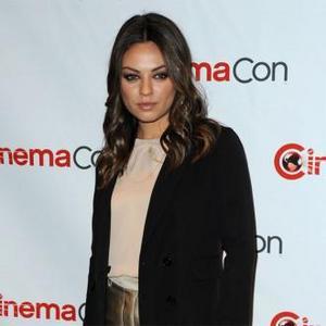 Mila Kunis Living With Ashton Kutcher?