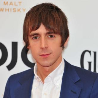 Miles Kane warms up with Stones