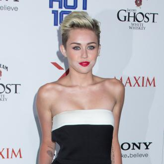 What Crisis? Miley Cyrus Proudly Dons Engagement Ring
