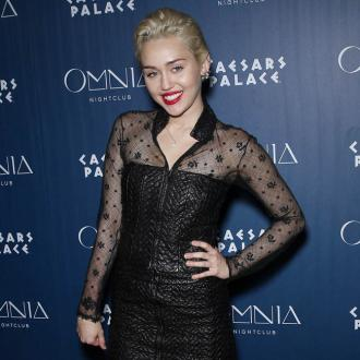 Miley Cryus Bares Breasts In Tribute To Joan Jett