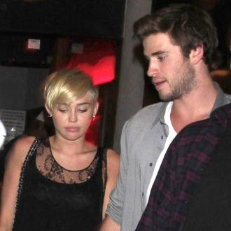 Miley Cyrus And Liam Hemsworth Working Through Problems