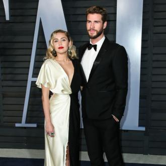 Miley Cyrus says 'hunky hubby' is 'recovering' as he misses premiere