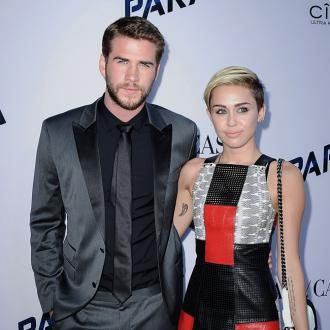 Miley Cyrus And Liam Hemsworth 'Strangers' At Premiere