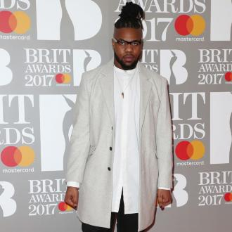 MNEK loses glasses at the 2017 BRIT Awards after party