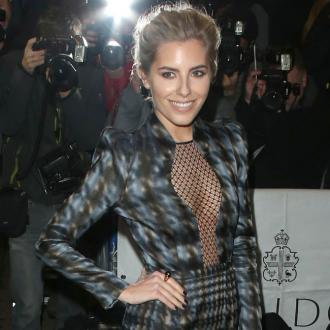 Mollie King enjoys time with pet pooch Alfie