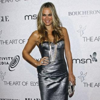 Molly Sims trying not to be overprotective