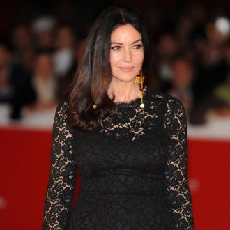 Monica Bellucci still learning as a parent