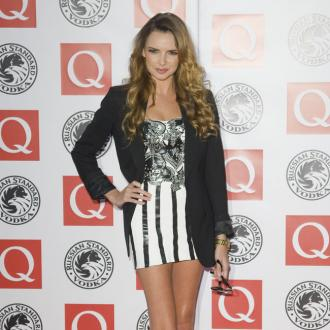 Nadine Coyle: I'm happy for Cheryl