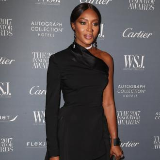 Naomi Campbell flips bird at animal rights activists