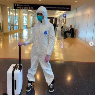 Naomi Campbell wears hazmat suit through LAX airport