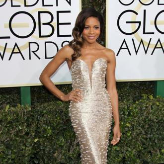Naomie Harris laid flat for one hour to avoid creasing Golden Globes gown