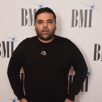 Naughty Boy album delayed due to naming issues