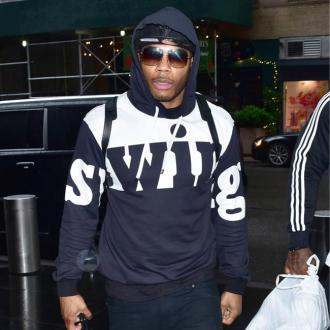 Nelly hits out at father in social media rant