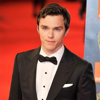 Nicholas Hoult Hides Heartbreak With Work