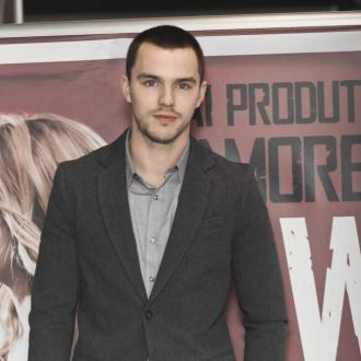 Nicholas Hoult Celebrates With Jennifer Lawrence