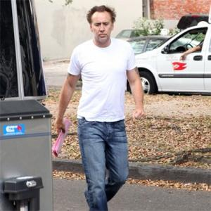 Nicolas Cage Awakened By Naked Man