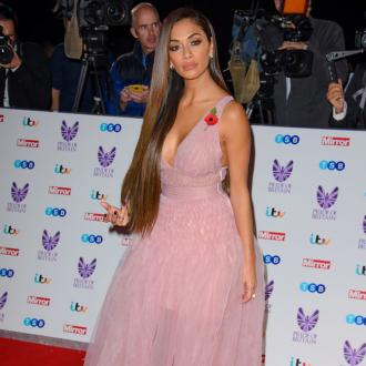 Nicole Scherzinger: My 'greatest weakness' is love