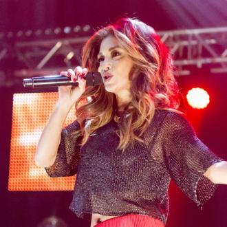 Nicole Scherzinger apologises to former bandmates