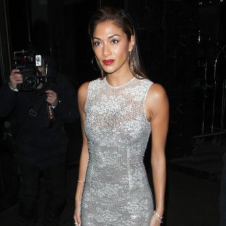 Nicole Scherzinger 'Trying To Stay Strong' After Split