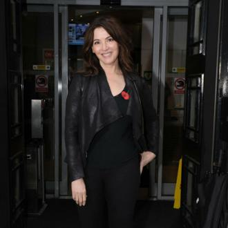 Nigella Lawson uses washing up gloves to exfoliate