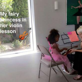 North West learning to play violin