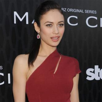 Olga Kurylenko Was Generous With First Pay Cheques