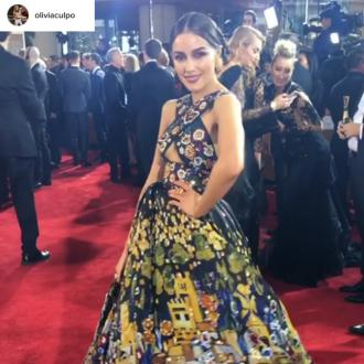 Olivia Culpo nearly fell over her dress at the Golden Globes