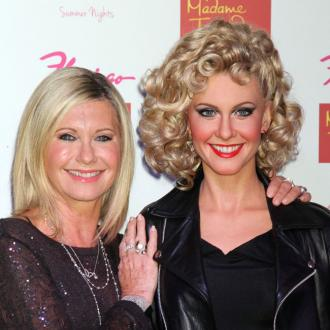 Olivia Newton-John says happiness is her beauty secret