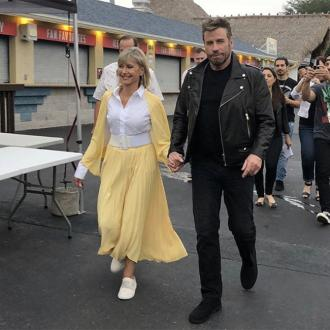 John Travolta and Olivia Newton-John don Grease outfits