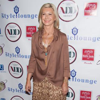 Olivia Newton John feeling positive about cancer treatment