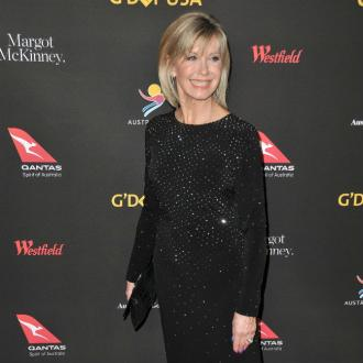 Olivia Newton-John pays tribute to Kelly Preston
