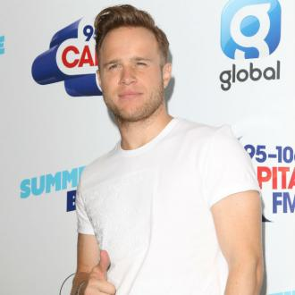Olly Murs is learning to bake