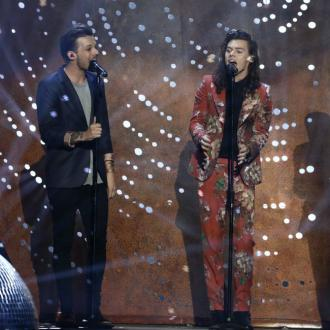 One Direction's Harry Styles and Louis Tomlinson thank fans