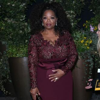 Oprah Winfrey and Idris Elba arrive for royal wedding