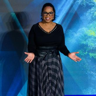 Oprah Winfrey trips onstage whilst talking about balance
