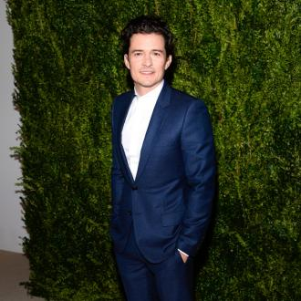 Orlando Bloom squeezed Stern nice and tight at Aniston wedding