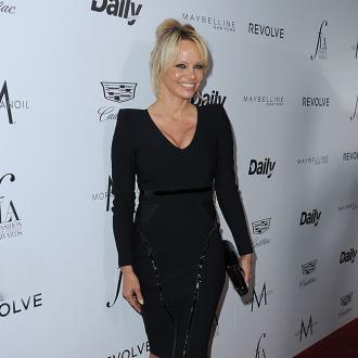 Pamela Anderson Brings Glamour To Julian Assange