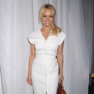 Pamela Anderson 'Flattered' By Julian Assange Romance Rumours