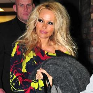 Pamela Anderson Adopts Indian Slum Dog