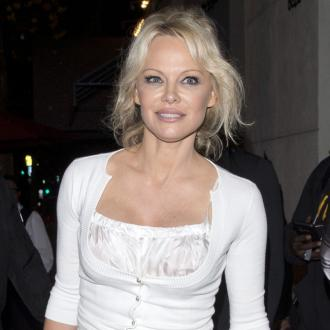 Pamela Anderson's marriage ended via text