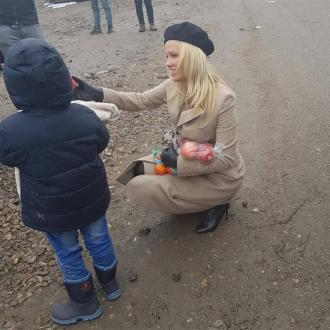 Pamela Anderson shocked during visit to meet refugees in Dunkirk