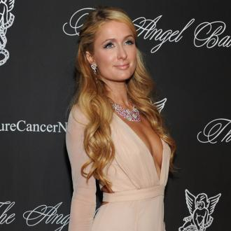 Paris Hilton Cuddles Big Cats