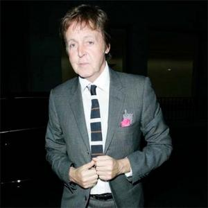 Paul Mccartney Works Round Daughter